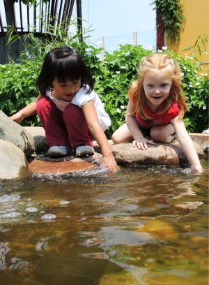 These girls were having a blast splashing in the water and were pretending to catch fish!